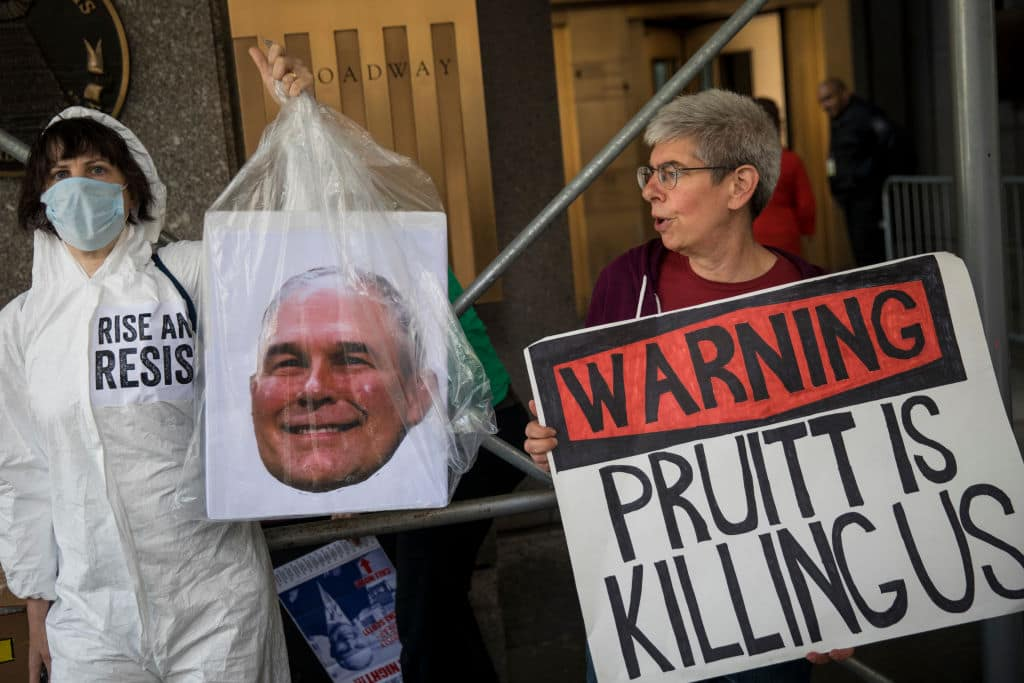 Protestors rally against Environmental Protection Agency (EPA) Administrator Scott Pruitt outside the federal office building that houses the New York City office of the Environmental Protection Agency (EPA), June 6, 2018, in New York City. (Photo by Drew Angerer/Getty Images)