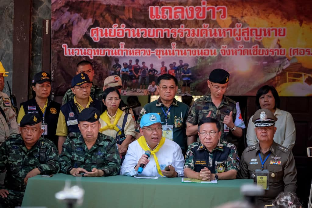 Chiang Rai Governor Narongsak Osot-tanakorn (center, blue hat), who heads the rescue operation, talk to the press at the Khun Nam Nang Non Forest Park to continue the rescue operation on July 04, 2018 in Chiang Rai, Thailand. (Photo by Linh Pham/Getty Images)