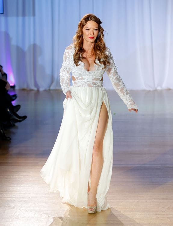 Reality TV actress Drita D'Avanzo walks the runway at the Reality of FASHION the Reality of AIDS fall 2013 fashion show during Mercedes-Benz Fashion Week at the Altman Building on February 9, 2013 in New York City. (Photo by Jemal Countess/Getty Images)