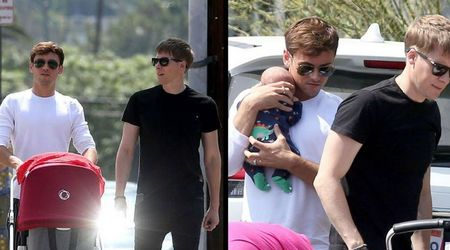 Olympic diver Tom Daley and husband Dustin Lance Black seen on an outing with their newborn son