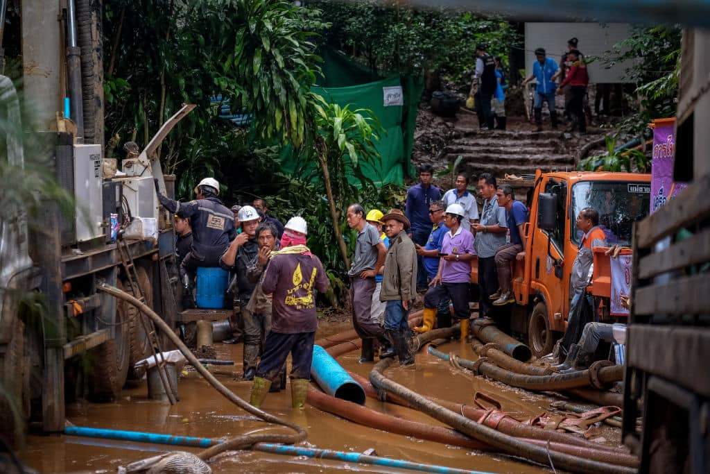 Rescue workers work on the water pumping machine at the entrance of Tham Luang Nang Non cave on July 2, 2018 in Chiang Rai, Thailand. (Getty Images)