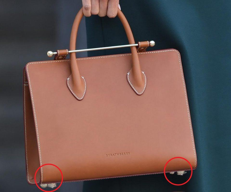 The Strathberry tote was fresh out of the box, with Meghan forgetting to remove the plastic from the bottom (Twitter)