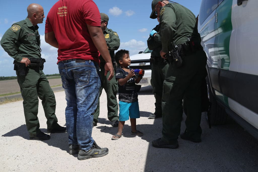 A boy and father from Honduras are taken into custody by U.S. Border Patrol agents near the U.S.-Mexico Border on June 12, 2018 near Mission, Texas. (Getty Images)