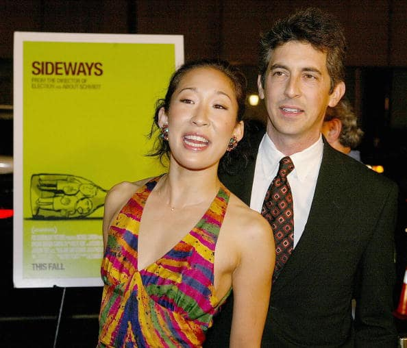 Actress Sandra Oh and ex-husband, director Alexander Payne, attend the premiere of 'Sideways' at the Academy of Motion Picture and Sciences on October 12, 2004 in Los Angeles, California. (Photo by Mark Mainz/Getty Images)