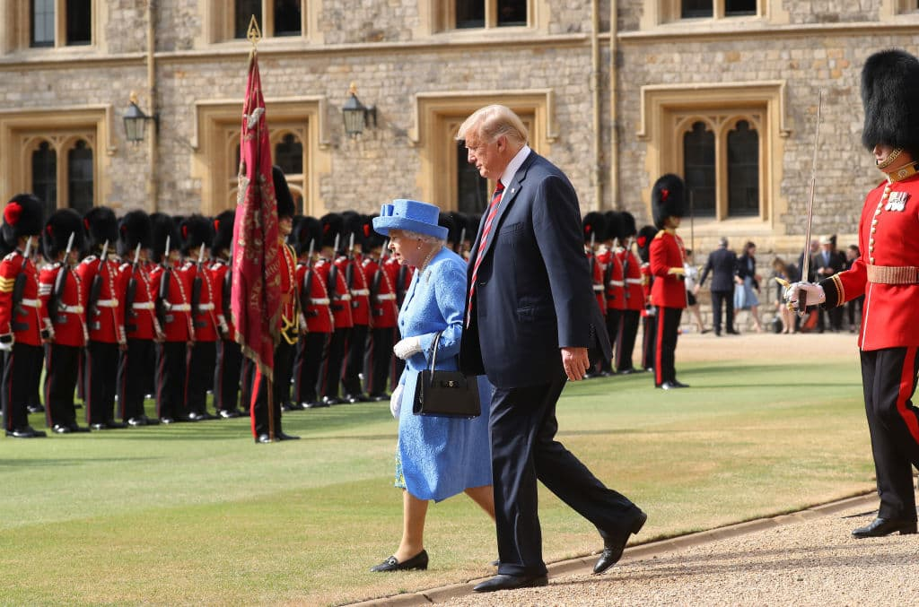 U.S. President Donald Trump and Britain's Queen Elizabeth II inspect a Guard of Honour, formed of the Coldstream Guards at Windsor Castle on July 13, 2018 in Windsor, England. (Getty Images)
