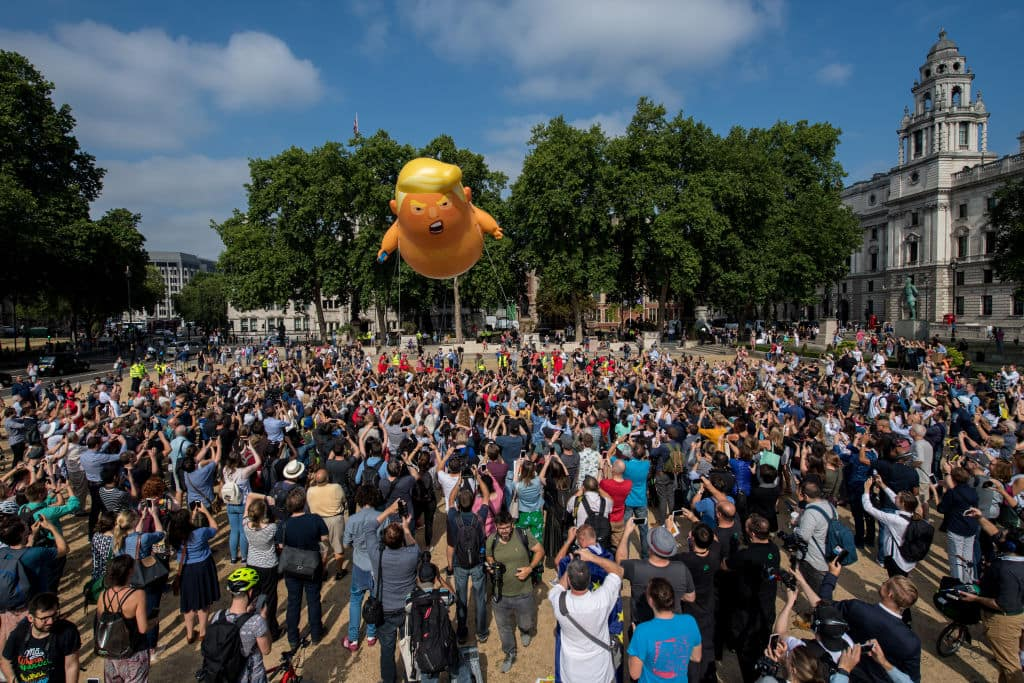 Demonstrators raise a six meter high effigy of Donald Trump, being dubbed the 'Trump Baby', in Parliament Square in protest against the U.S. President's current visit to the United Kingdom on July 13, 2018 in London, United Kingdom. (Getty Images)