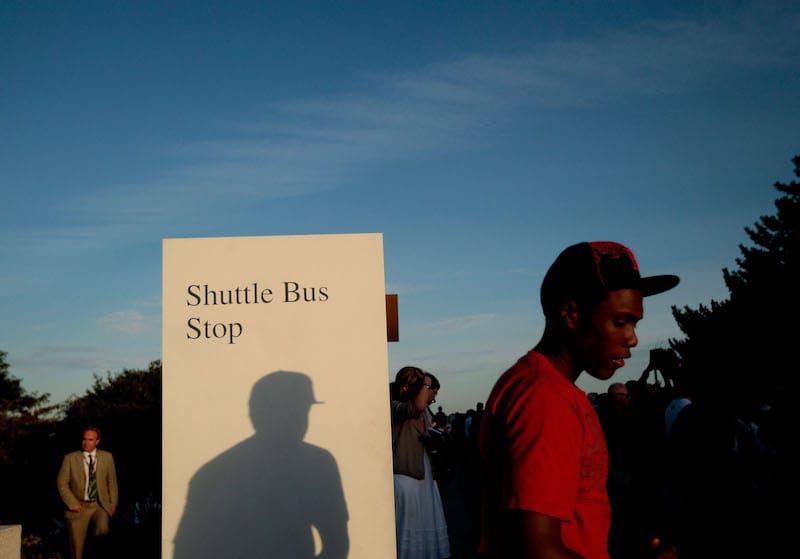 A teen waits near a bus stop outside the John F. Kennedy Presidential Library in Boston, Massachusetts. (Getty Images)
