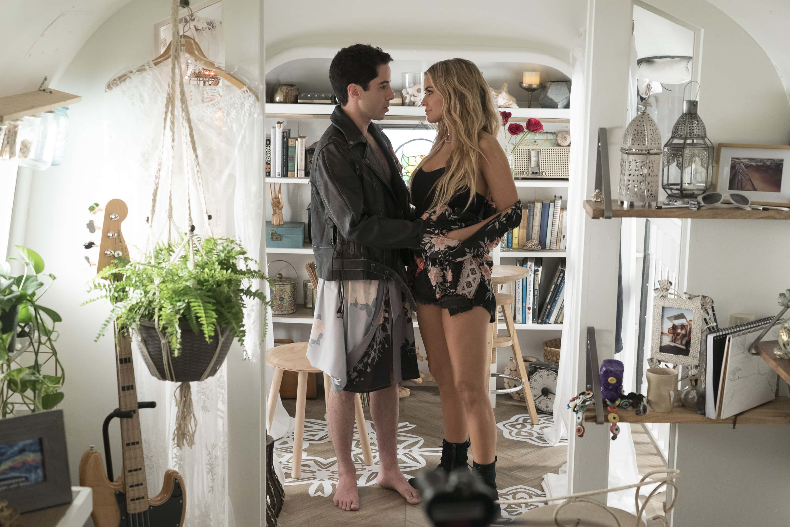 Benji Aflalo and Carmen Electra in a scene from Alone Together (Freeform)
