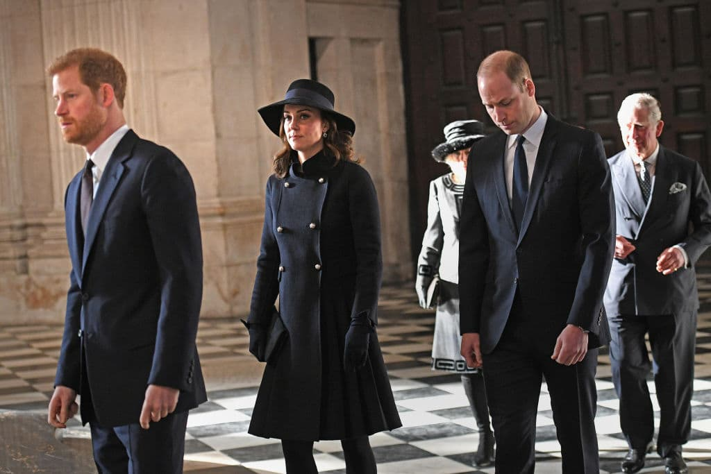 Kate Middleton, Prince William and Prince Harry at the Grenfell Tower National Memorial Service at St Paul's cathedral on December 14, 2017 in London. (Photo by Stefan Rousseau-WPA Pool Getty Images)