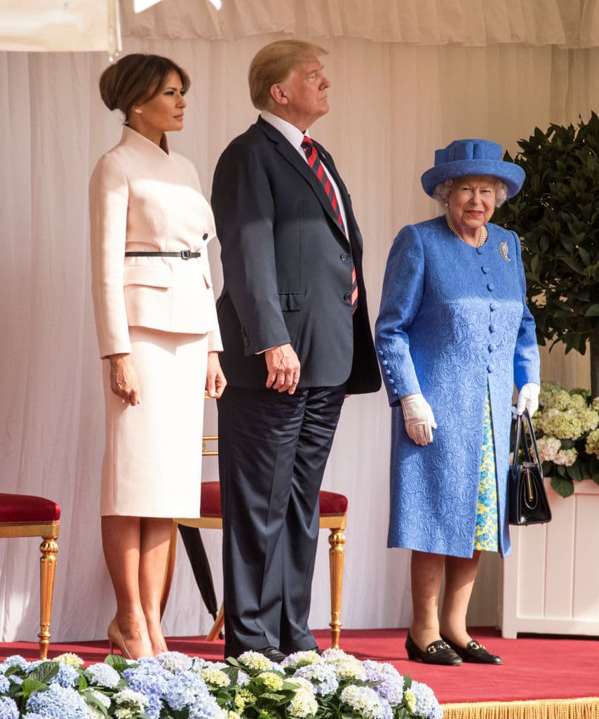 U.S. President Donald Trump and first lady Melania Trump stand with Britain's Queen Elizabeth II on the dais in the Quadrangle of Windsor Castle on July 13, 2018 in Windsor, England. (Getty Images)