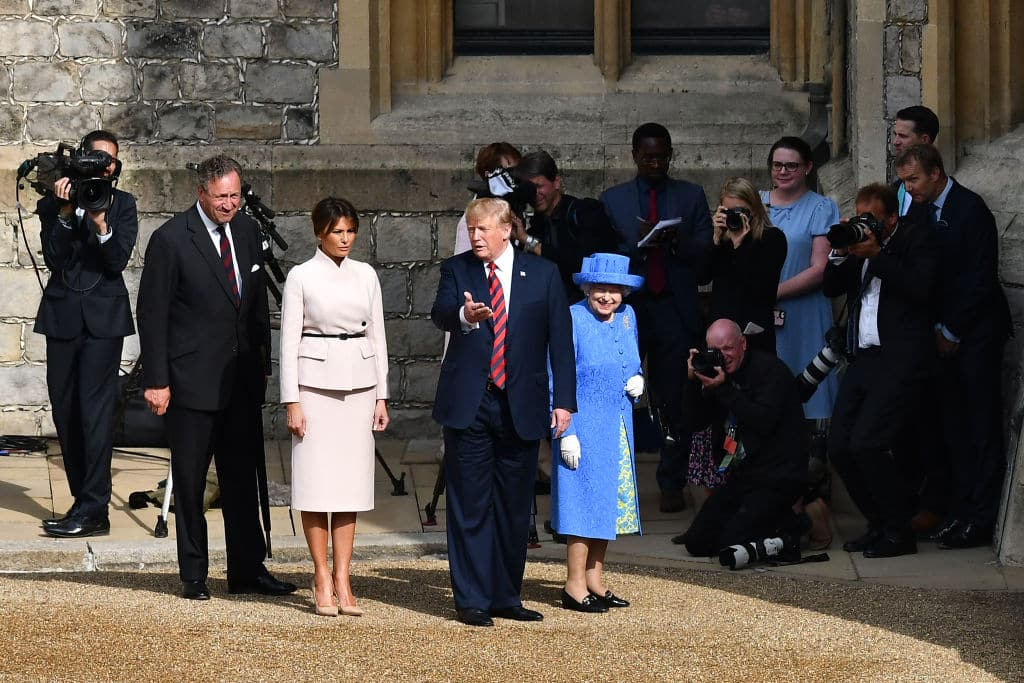 US President Donald Trump (C) gestures as he and US First Lady Melania Trump (L) follow Britain's Queen Elizabeth II (R) through the Quadrangle toward an entrance to Windsor Castle on July 13, 2018 in Windsor, England. (Getty Images)
