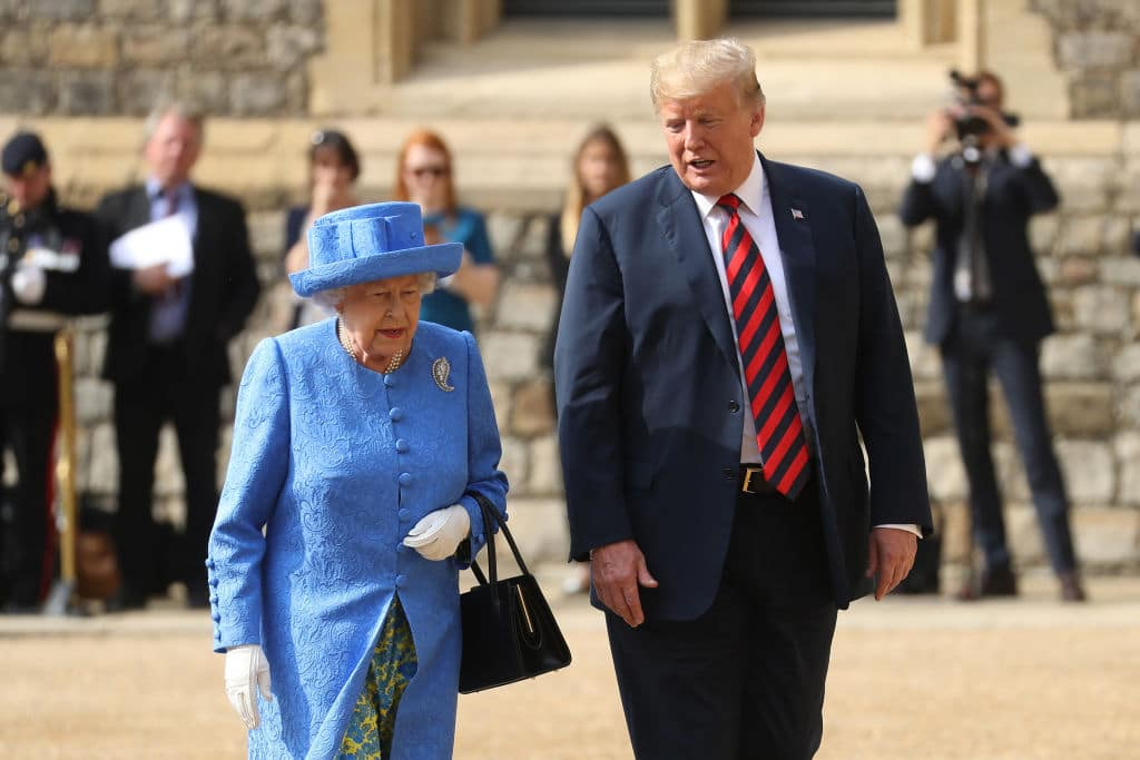 Queen Elizabeth II and President of the United States, Donald Trump inspect an honor guard at Windsor Castle on July 13, 2018 in Windsor, England. (Getty Images)