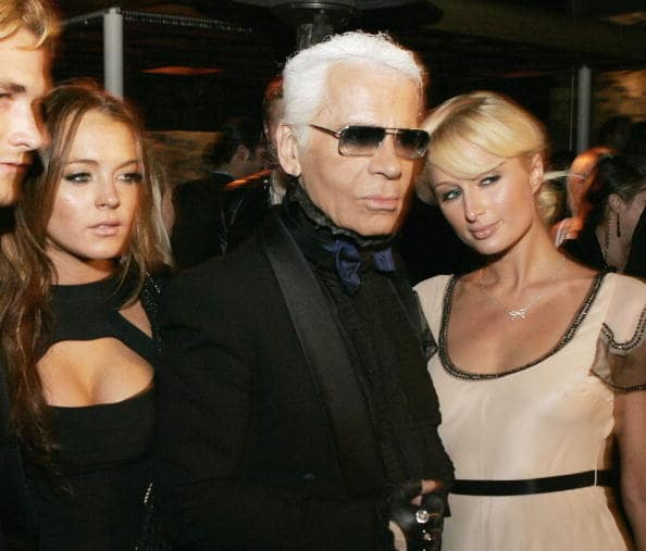 Actress Lindsay Lohan, designer Karl Lagerfeld and Paris Hilton pose at the International Launch of Dom Perignon Rose Vintage 1996 Champagne by Karl Lagerfeld on June 2, 2006 in Beverly Hills, California. (Photo by Kevin Winter/Getty Images)