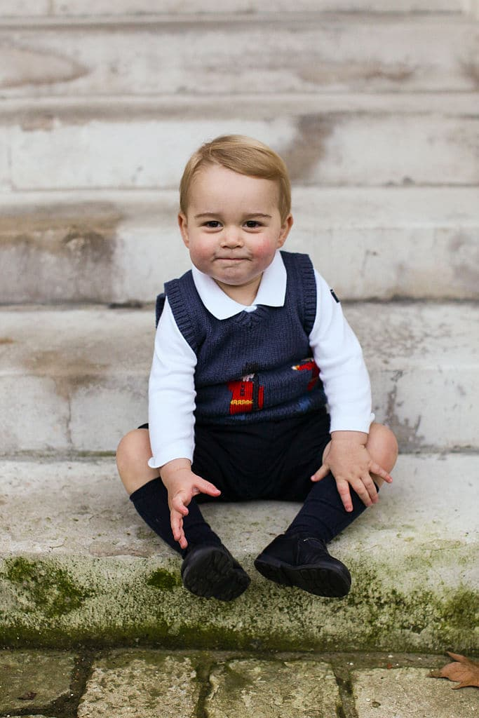 Prince George sits for his official Christmas picture in a courtyard at Kensington Palace in late November of 2014 in London, England (Getty Images)