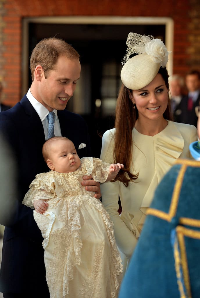 Prince William and Duchess of Cambridge arrive holding their son Prince George at Chapel Royal in St James's Palace, ahead of his christening (Getty Images)