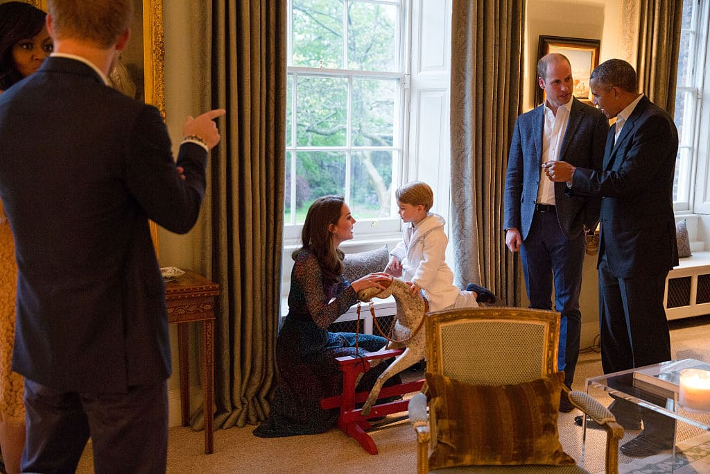 President Barack Obama talks with the Prince William as Duchess of Cambridge plays with Prince George as First Lady Michelle Obama talks with Prince Henry at Kensington Palace on April 22, 2016 (Getty Images)