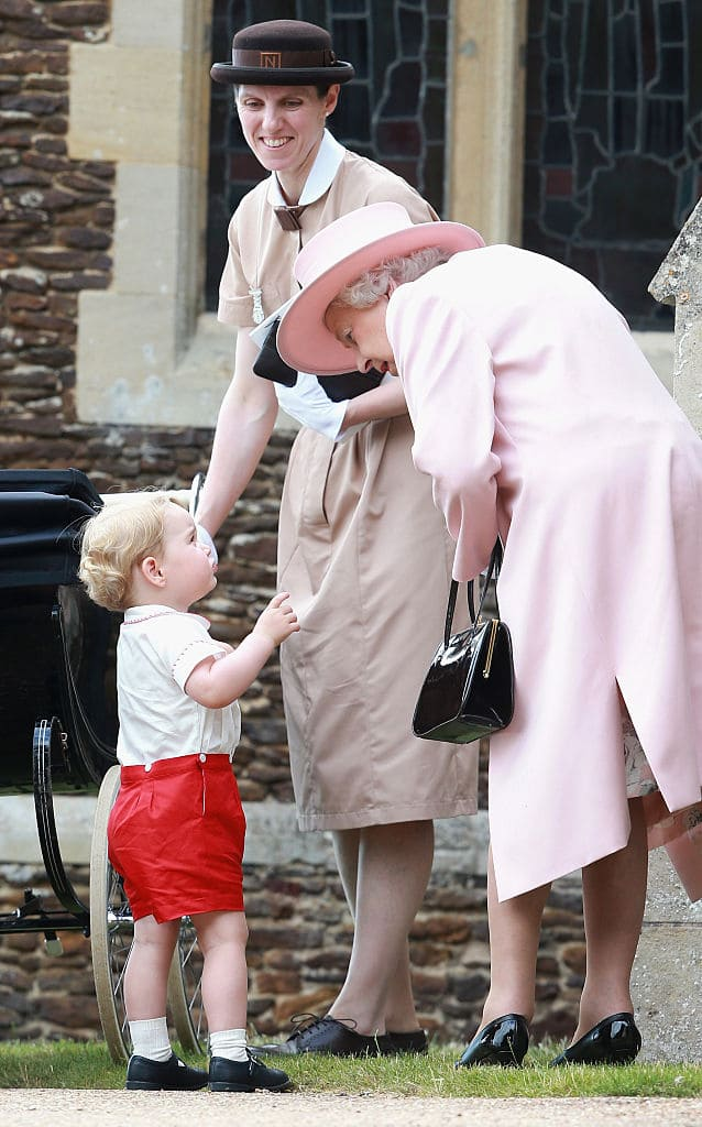 Prince George of Cambridge talks to Queen Elizabeth II outside the Church of St Mary Magdalene on the Sandringham Estate for the Christening of Princess Charlotte of Cambridge on July 5, 2015  (Photo by Chris Jackson/Getty Images)