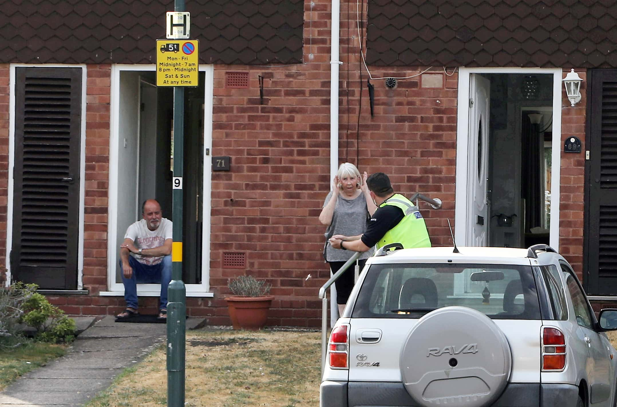 Neighbours told how they heard the mum screaming before seeing her cling to the vehicle and being dragged down the street (Image: SWNS)