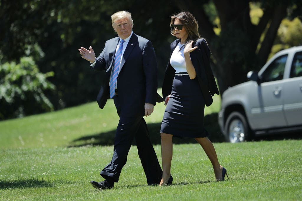 U.S. President Donald Trump and first lady Melania Trump walk across the South Lawn as they depart the White House July 18, 2018 in Washington, DC. (Getty Images)