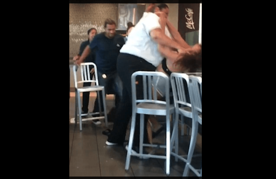 The employee can be seen body-slamming the customer. (YouTube)