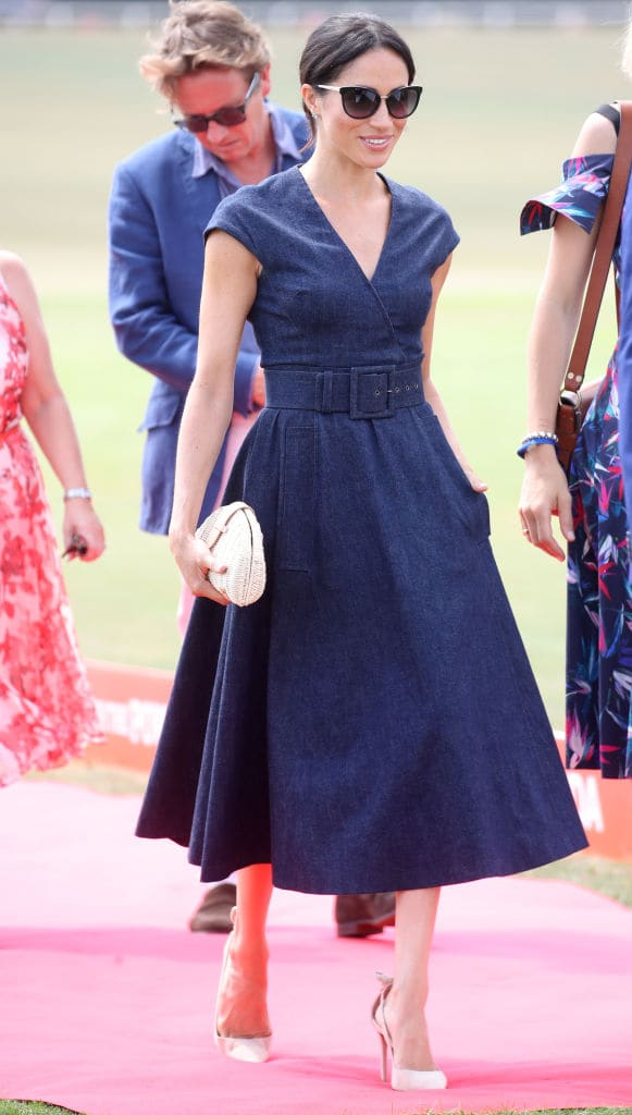 Meghan Markle's denim dress was cinched at her waist along with the help of belt detail (Getty Images)