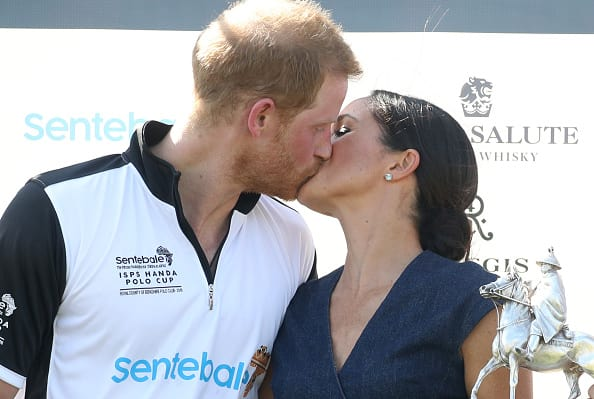 Meghan Markle and Prince Harry kiss at the Sentebale Polo 2018 held at the Royal County of Berkshire Polo Club on July 26, 2018 in Windsor, England. (Photo by Chris Jackson/Getty Images)