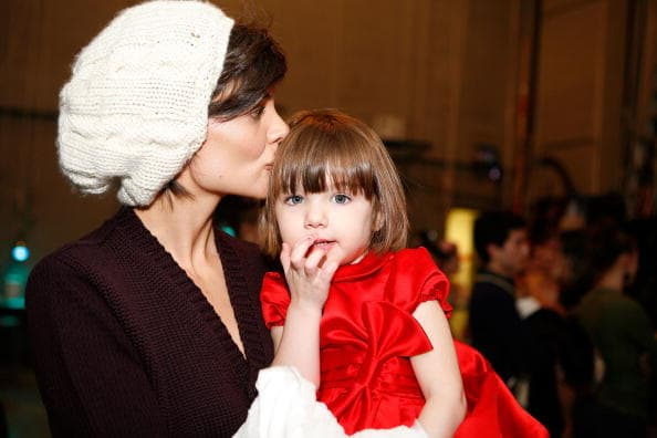 Actress Katie Holmes and her daughter Suri Cruise visit 'The Nutcracker' at the New York City Ballet on December 14, 2008 in New York City. (Photo by Amy Sussman/Getty Images)