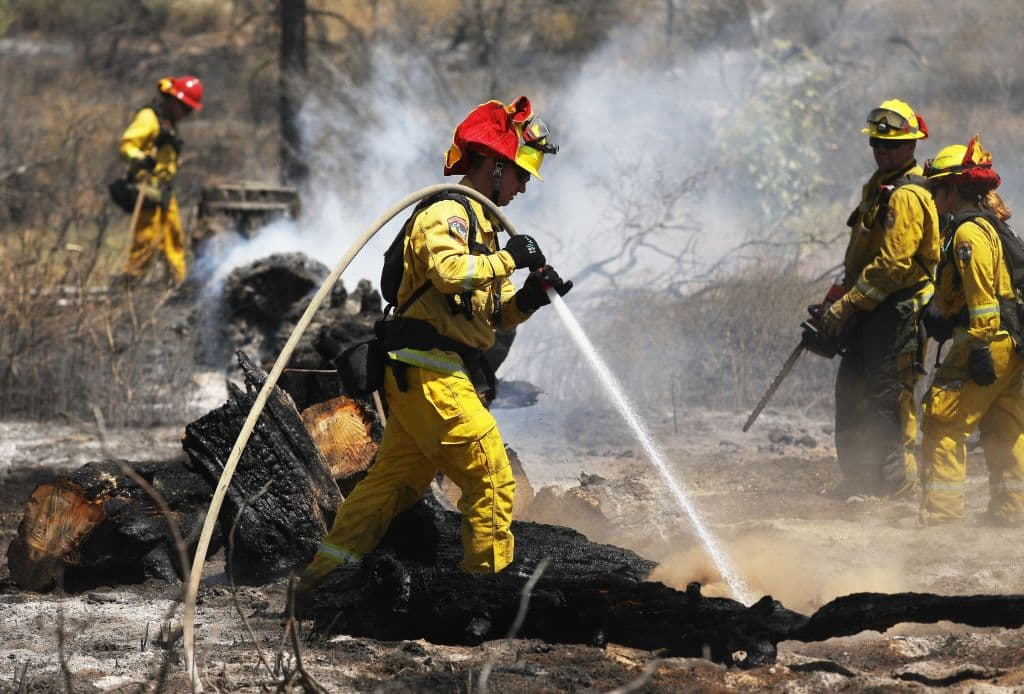 Firefighters work as the Cranston Fire burns in San Bernardino National Forest on July 26, 2018, near Idyllwild, California. (Photo by Mario Tama/Getty Images)