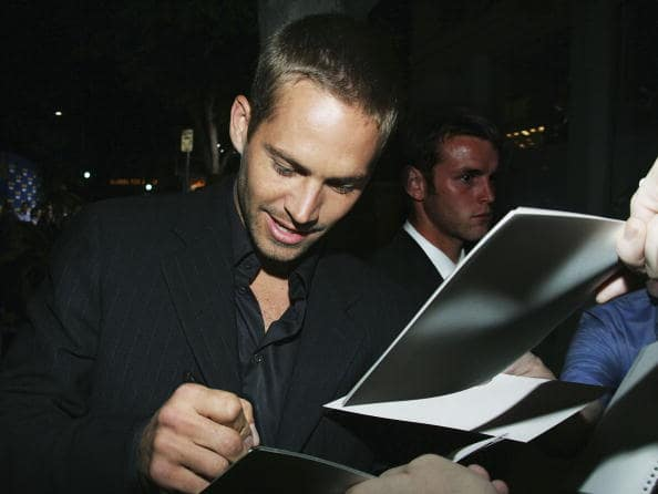 Paul Walker attends the premiere of Sony Pictures 'Into the Blue' at the Mann Village Theatre on September 21, 2005 in Westwood, California. (Photo by Mark Mainz/Getty Images)