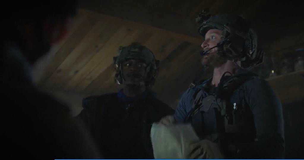 Eric Ladin (right) as Trevor Wozniak (Source: IMDb)