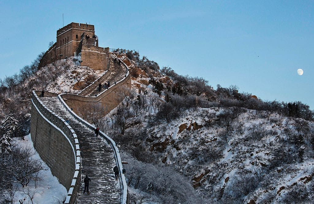 The moon rises as snow is seen on the Great Wall after a snowfall on November 23, 2015 near Beijing, China. (Getty Images)