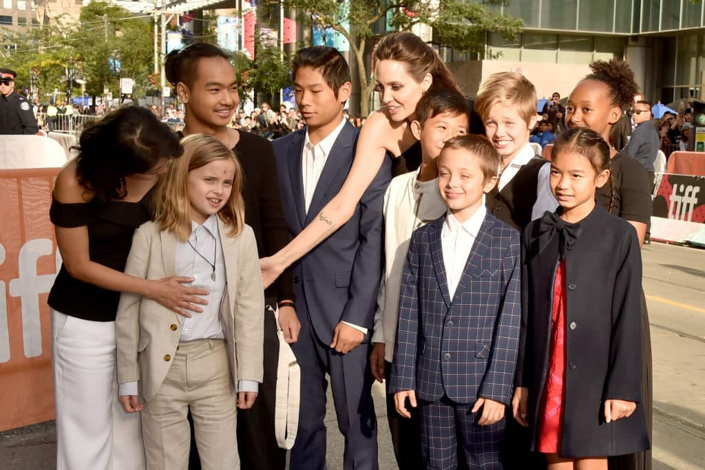(L-R) Loung Ung, Vivienne Jolie-Pitt, Maddox Jolie-Pitt, Pax Jolie-Pitt, Angelina Jolie, Kimhak Mun, Knox Jolie-Pitt, Shiloh Jolie-Pitt, Zahara Jolie-Pitt and Sareum Srey Moch attend the 'First They Killed My Father' premiere during the 2017 Toronto International Film Festival at Princess of Wales Theatre on September 11, 2017 in Toronto, Canada. (Photo by Alberto E. Rodriguez/Getty Images)