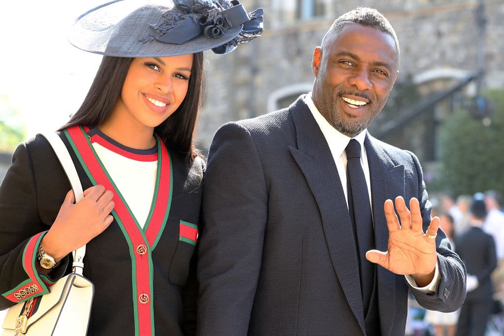 Idris Elba and Sabrina Dhowre arrive at St George's Chapel at Windsor Castle before the wedding of Prince Harry to Meghan Markle on May 19, 2018 in Windsor, England. (Photo by Gareth Fuller - WPA Pool/Getty Images)