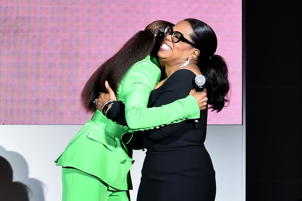 Issa Rae hugs Oprah Winfrey onstage during the 2018 CFDA Fashion Awards at Brooklyn Museum on June 4, 2018 in New York City. (Photo by Theo Wargo/Getty Images)
