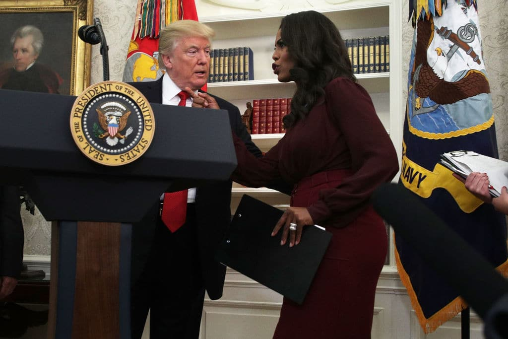U.S. President Donald Trump listens to Director of Communications for the White House Public Liaison Office Omarosa Manigault during an event in the Oval Office of the White House October 24, 2017 in Washington, DC. (Getty Images)