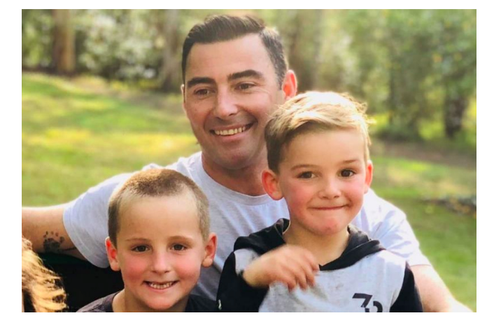 Brad pictured with his children in this image. (GoFundMe)