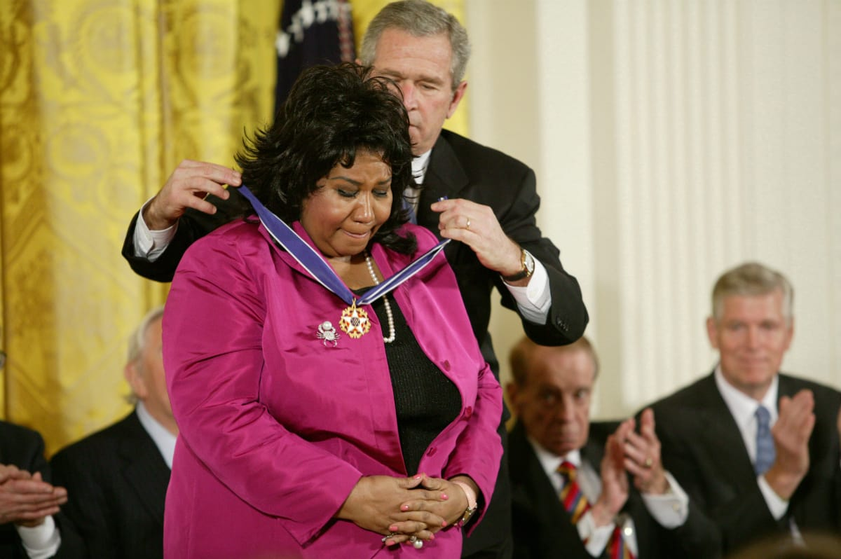 Aretha L. Franklin and President George W. Bush at the Freedom Awards Ceremony at the White House in Washington D.C. on November 9, 2005. (Photo by Douglas A. Sonders/Getty Images)