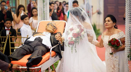 Tear-jerking moment! Dying father fulfills his last wish to walk his daughter down the aisle on stretcher