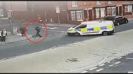 WATCH: Moment police officer chasing a suspect on foot is run over by colleague's van