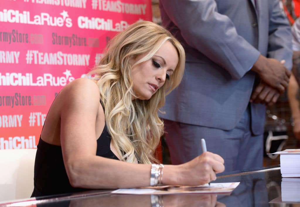 Stormy Daniels autographs a photo during a fan meet and greet at Chi Chi LaRue's on May 23, 2018 in West Hollywood, California. (Photo by Tara Ziemba/Getty Images)