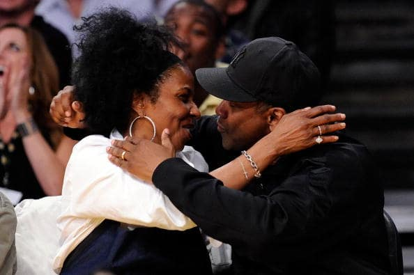 Denzel Washington and wife Pauletta Pearson kiss for the 'Kiss Cam' during Game One of the Western Conference Finals during the 2009 NBA Playoffs between the Los Angeles Lakers and the Denver Nuggets at Staples Center on May 19, 2009 in Los Angeles, California. (Photo by Kevork Djansezian/Getty Images)