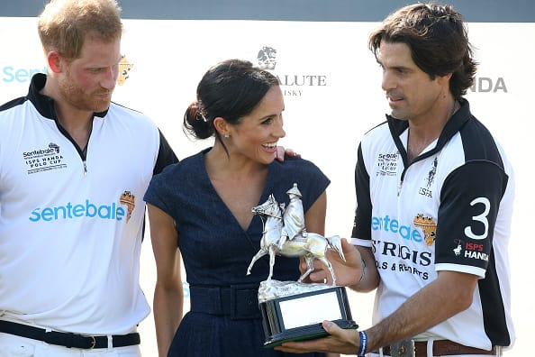 Nacho Figuares of Sentebale St. Regis presents the Sentebale Polo 2018 trophy with Meghan Duchess of Sussex and Prince Harry Duke of Sussex after the Sentebale Polo 2018 held at the Royal County of Berkshire Polo Club on July 26, 2018 in Windsor, England. (Photo by Chris Jackson/Getty Images)