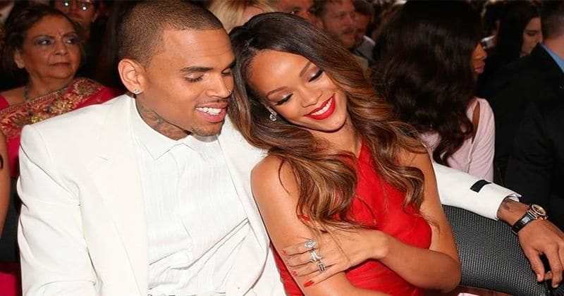 Woman-battering Chris Brown is still texting Rihanna...and her fans won't stand for it!