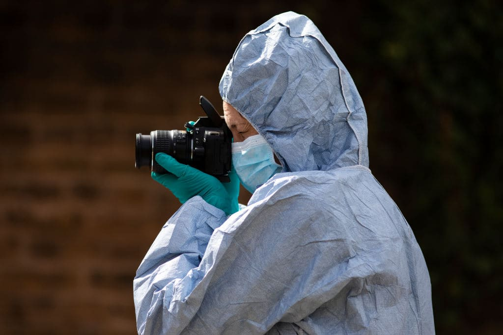 A forensic expert works at the scene of the incident. (Getty Images)