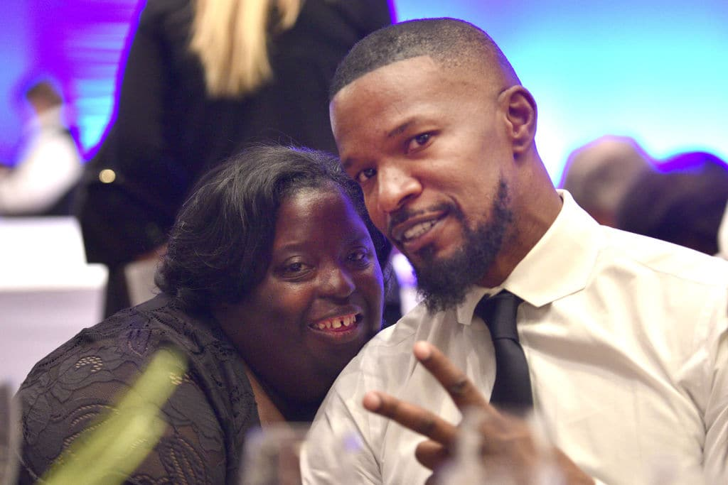 DeOndra Dixon and Jamie Foxx at the Global Down Syndrome Foundation's 9th annual 'Be Beautiful Be Yourself' Fashion Show in Denver, Colorado, in 2017 (Source: Getty Images)