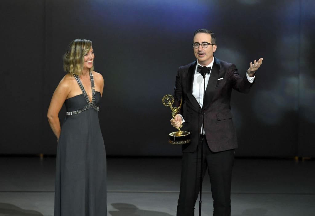 Liz Stanton (L) and John Oliver accept the Outstanding Variety Talk Series award for 'Last Week Tonight with John Oliver' onstage during the 70th Emmy Awards at Microsoft Theater on September 17, 2018 in Los Angeles, California. (Photo by Kevin Winter/Getty Images)