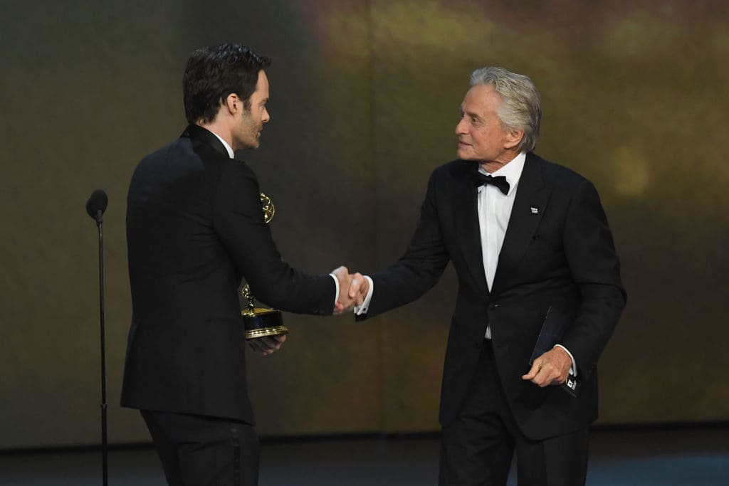 Bill Hader (L) accepts the Outstanding Lead Actor in a Comedy Series award for 'Barry' from Michael Douglas onstage during the 70th Emmy Awards at Microsoft Theater on September 17, 2018 in Los Angeles, California. (Photo by Kevin Winter/Getty Images)
