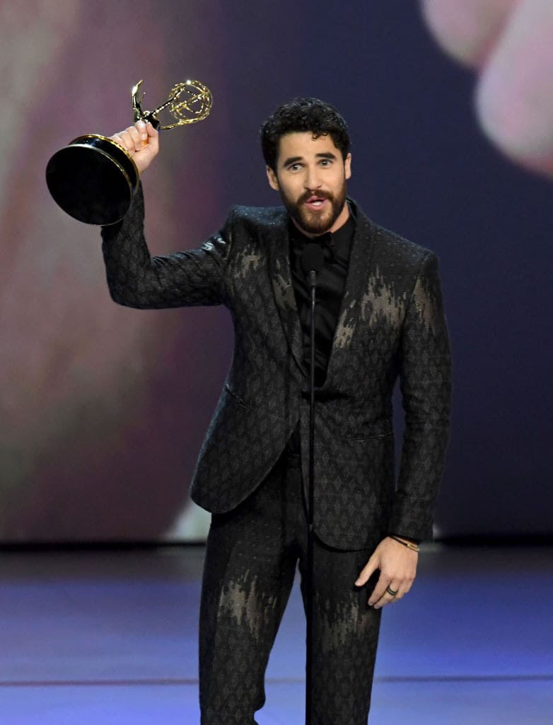 Darren Criss accepts the Outstanding Lead Actor in a Limited Series or Movie award for 'The Assassination of Gianni Versace: American Crime Story' onstage during the 70th Emmy Awards at Microsoft Theater on September 17, 2018 in Los Angeles, California. (Photo by Kevin Winter/Getty Images)