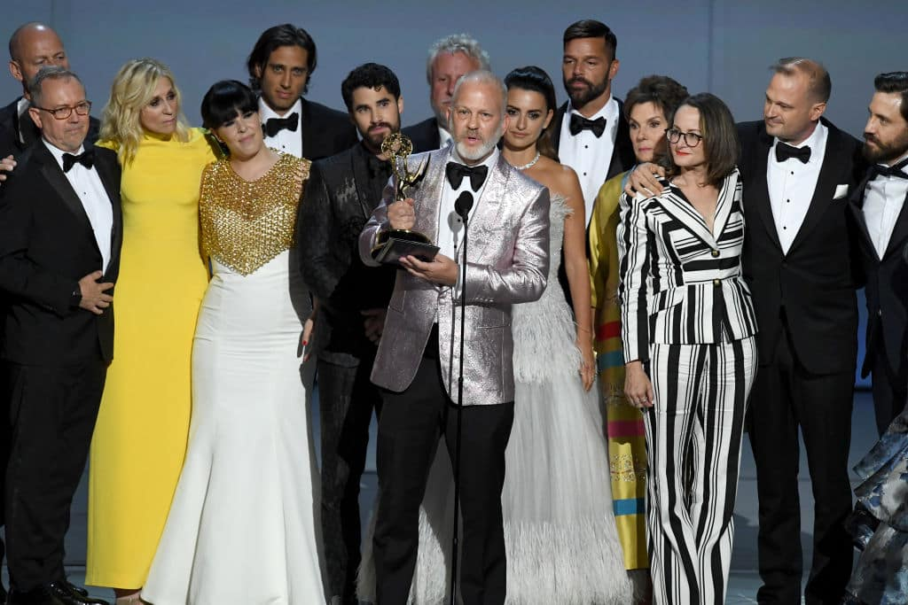 yan Murphy (C) and cast and crew accepts the Outstanding Limited Series award for 'The Assassination of Gianni Versace: American Crime Story' onstage during the 70th Emmy Awards at Microsoft Theater on September 17, 2018 in Los Angeles, California. (Photo by Kevin Winter/Getty Images)