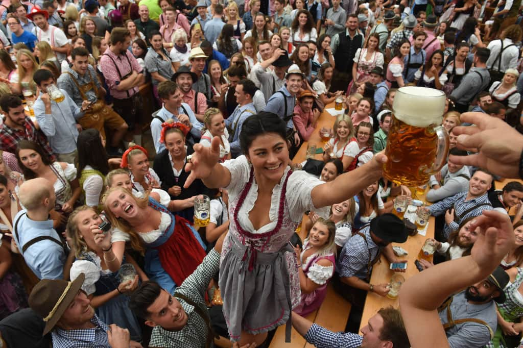 Visitors drink beer during the 185th Oktoberfest, Munich's annual beer festival, on September 22, 2018 in Munich, southern Germany. - The world's largest beer festival is held from September 22 until October 7, 2018. (CHRISTOF STACHE/AFP/Getty Images)